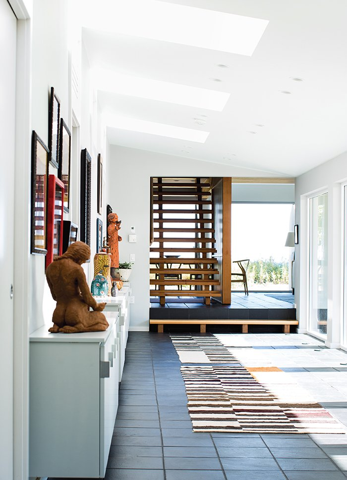 """Staircase and Wood Tread """"The hallway and courtyard are synonymous with each other visually, which has this very joyful quality about it,"""" says architect David Salmela.  Photo 2 of 8 in A Modern Lakeside Home in Wisconsin"""