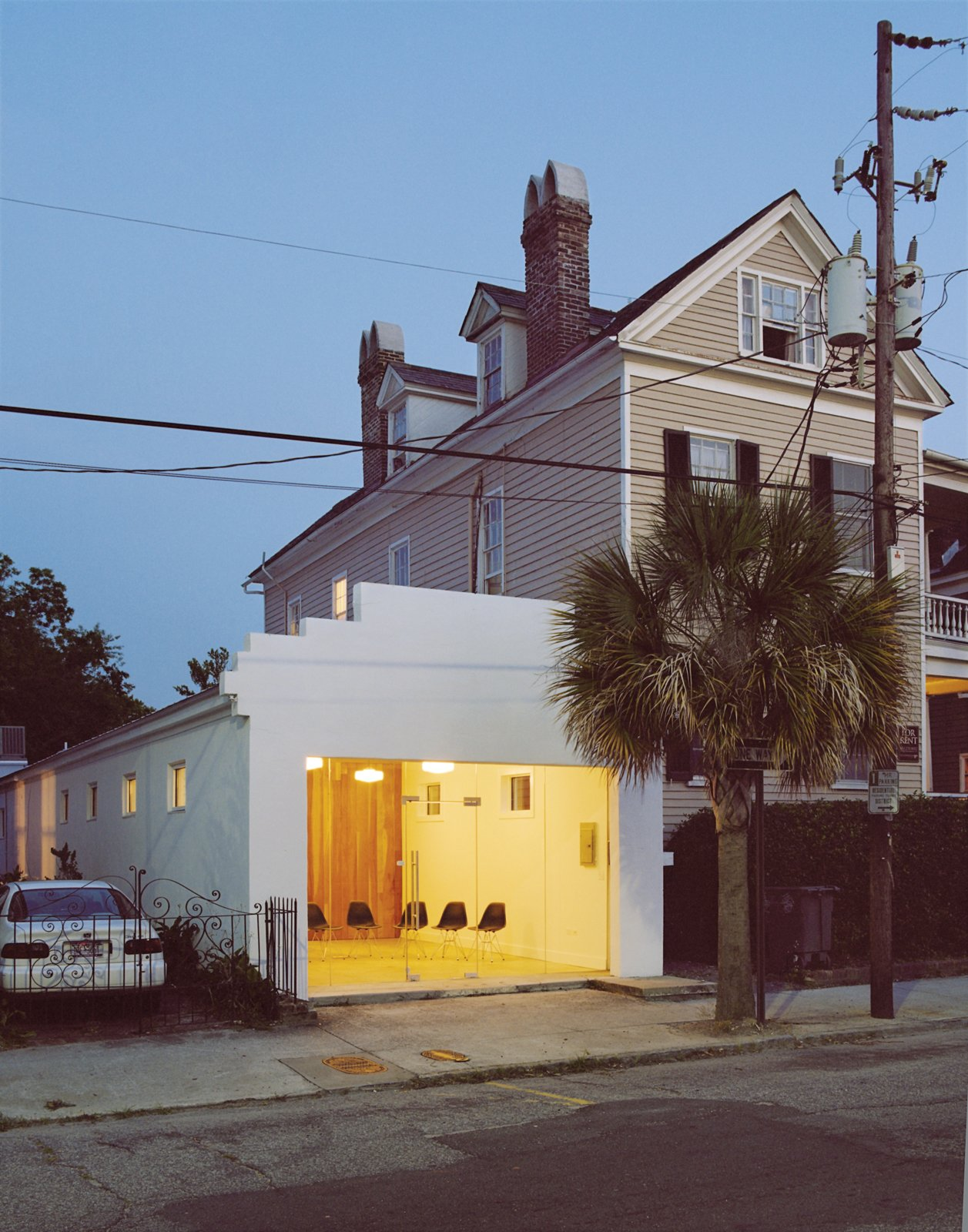 The 1,200-square-foot building, which at one time or another has been a church, laundromat, ice cream parlor, and hat shop was renovated by Thompson Young Design.  Photo 2 of 6 in Modern Across America: Charleston, South Carolina from Raise High the Roof Beams