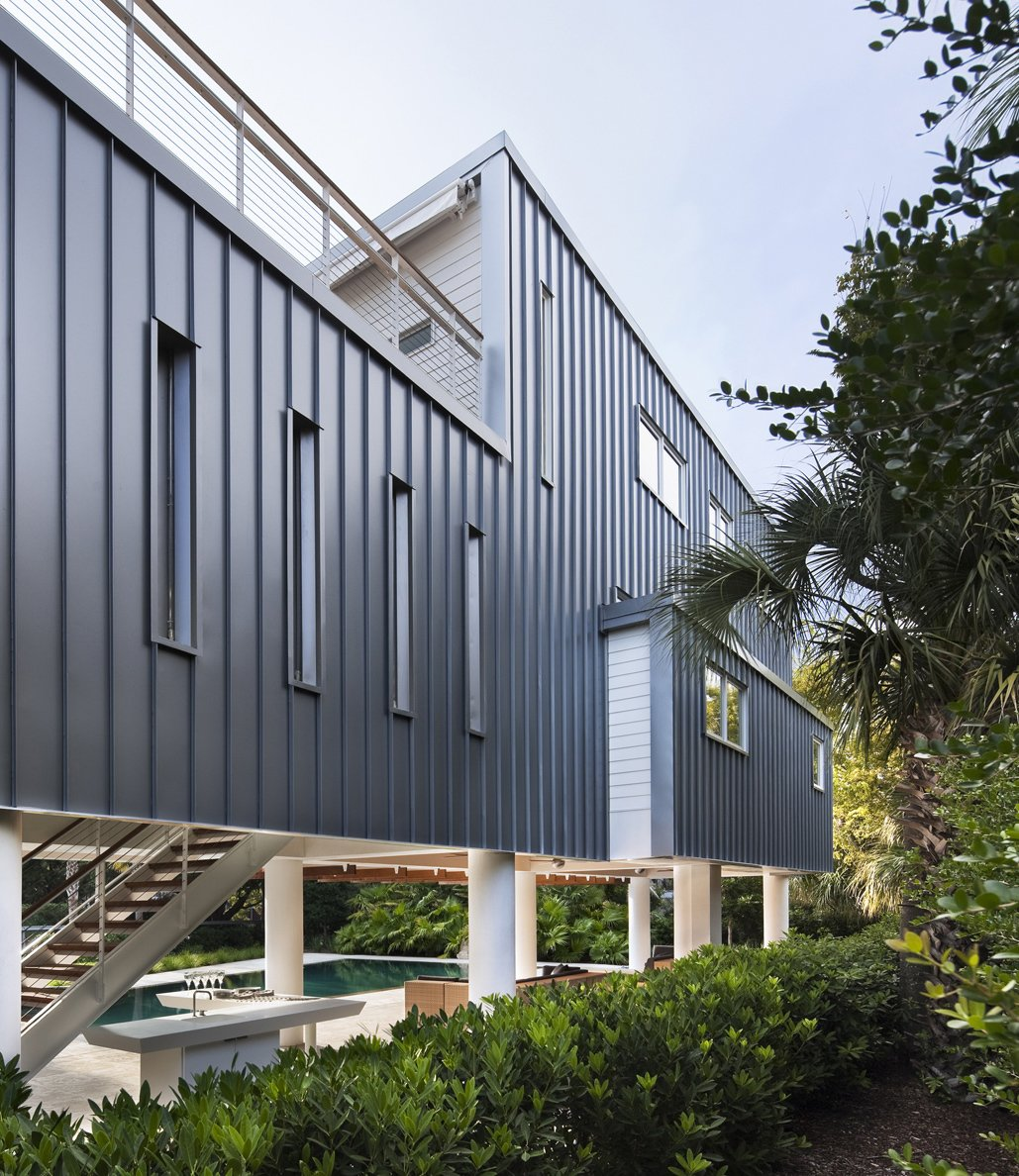 Exterior, House Building Type, and Metal Siding Material SYA used standing-seam metal for the rear cladding of the addition, a common local roofing material. Photo: Michael Moran.  Photo 3 of 6 in Modern Across America: Charleston, South Carolina from Summer-Ready Modern Pavilion in South Carolina