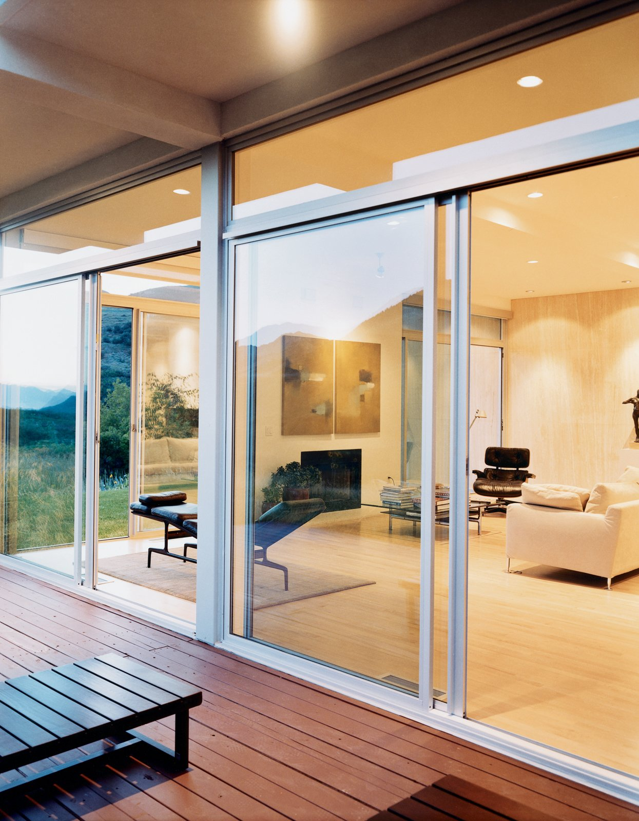 Doors, Sliding Door Type, Exterior, and Metal The living room utilizes Eames lounges and a B&B Italia sofa to create a spare but comfortable environment. Sliding glass doors provide ample ventilation.  Photo 2 of 6 in Modern Across America: Salt Lake City from Modern Awakening