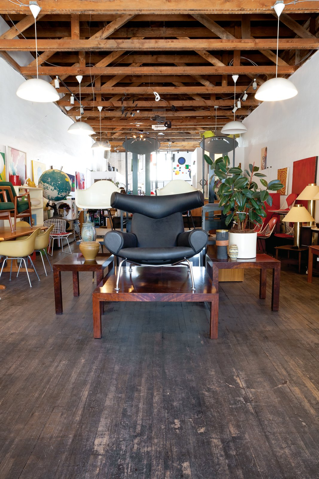 He's also found rosewood Milo Baughman tables   and an Ox Chair designed by Hans Wegner.  Photo 6 of 6 in Modern Across America: Salt Lake City