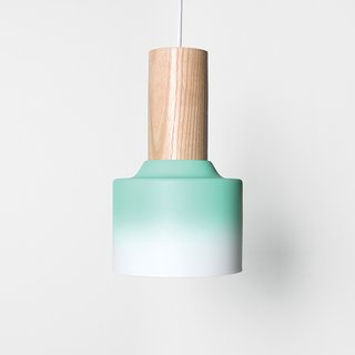 Hombre pendant light by Damm. St. Petersburg, Florida–based design studio Damm worked with motorcycle painters to achieve the gradient finish on its ten-inch tall ceramic-and-ash pendant light.