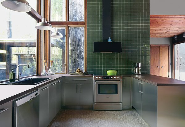 """""""I didn't want marble or granite because they aren't sustainable,"""" says Seo. """"Laminate is one of the few surfaces recognized by the U.S. Green Building Council toward LEED certification. Plus it's affordable and I liked the way it looked—a triple whammy.""""  Renovated Kitchens We Love by Zachary Edelson"""