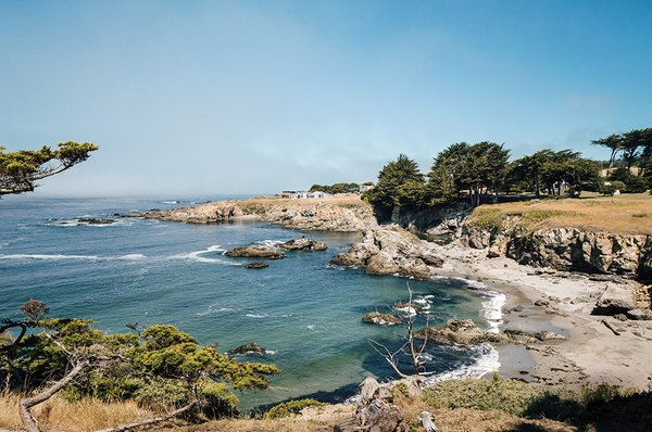 The view from Gabriel Ramirez's property in Sea Ranch, California, where meadow grasses and cypress trees give way to craggy cliffs and the lapping Pacific Ocean. His house joins those that a cohort of forward-thinking architects built along this stretch of coast in the 1960s.