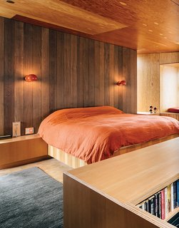 After buying a site overlooking an inlet called Smuggler's Cove, Gabriel Ramirez asked two architects—Norman Millar, dean of the Woodbury School of Architecture, and Judith Sheine, head of the architecture department at the University of Oregon—to design the house. Boi sconces, which David Weeks designed for Ralph Pucci, illuminate the bedroom in this Sea Ranch residence.