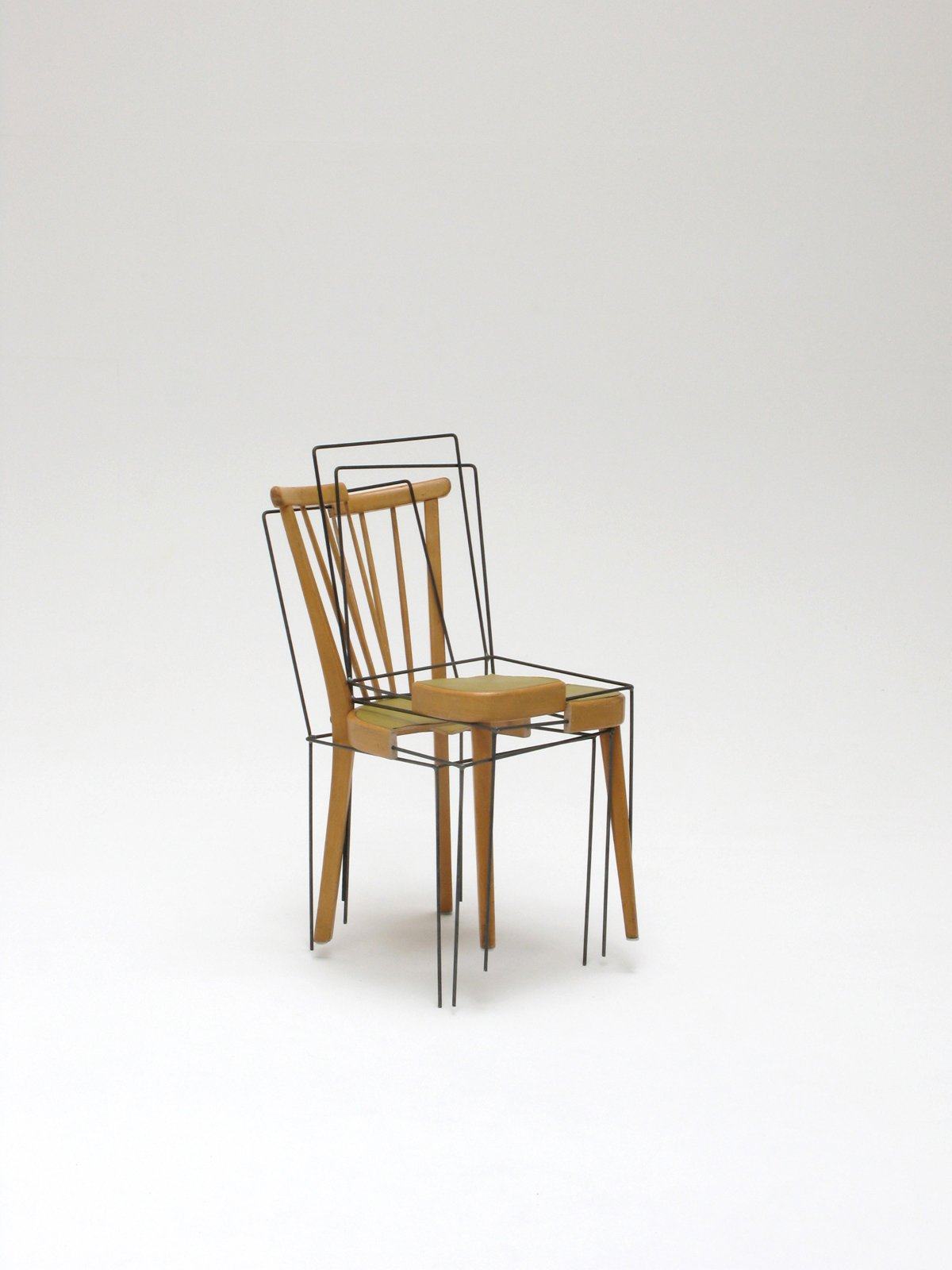Platzhalter-Stuhl by German designer Julian Sterz is another rumination on object and perception—one conventional chair becomes four new, different chairs, each with a missing part replaced with a metal frame.  Emerging Design Talent at imm Cologne by Amanda Dameron