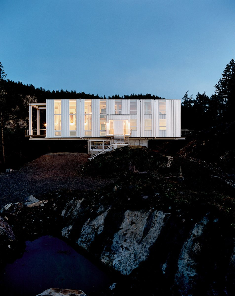 """Set amongst the Washington woods, architect Peter Anderson explains that """"the floating nature of the design would not have been possible with conventional onsite framing techniques, nor any of the currently marketed modular home designs."""" Photo by: John Clark  Futuristic Prefab Homes by Robert Gordon-Fogelson from Modern Mountainside Homes"""