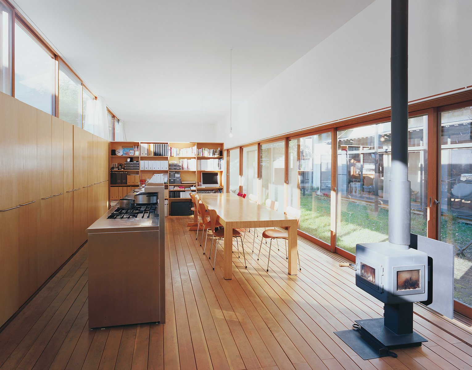 This inviting Japanese home built from a palette of steel, wood and concrete is the product of architects Takaharu and Yui Tezuka. Photo by: Adam Friedberg  Modern Wood-Burning Stoves by Megan Hamaker