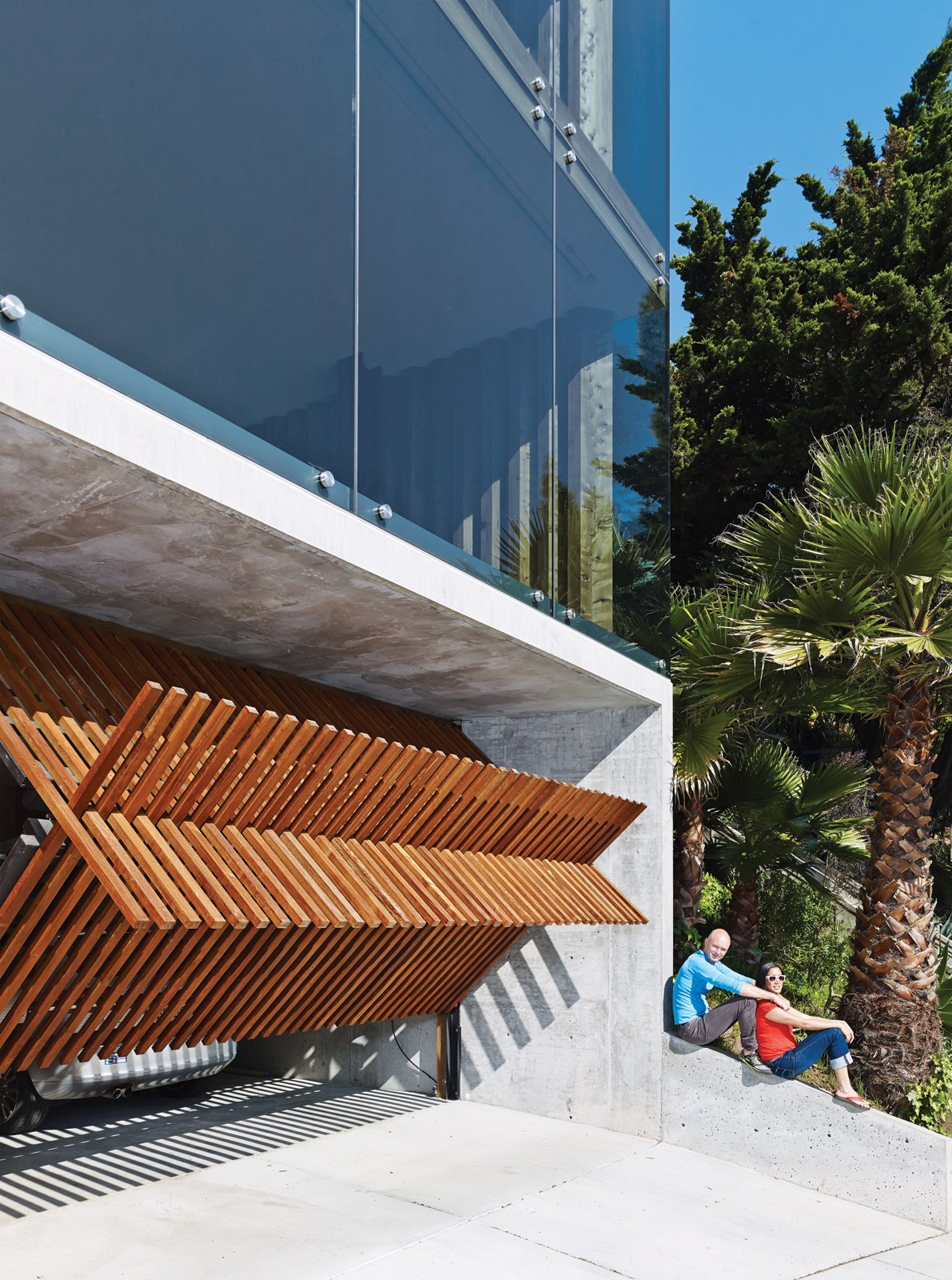 Garage and Attached Garage Room Type At street level, the wooden garage door opens its toothed maw.  Garage from Striking Slatted Wood and Glass Home in San Francisco