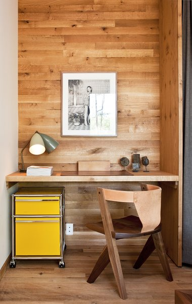 A yellow Pedestal filing cabinet by USM is tucked under a built-in desk in the guest bedroom. The leather-back chair was designed by Michael Robbins, a furniture designer based in New York's Hudson Valley.