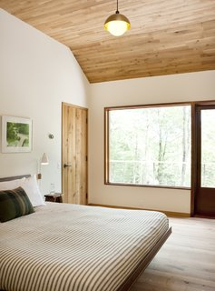 White oak makes a return appearance on the ceiling in the master bedroom.