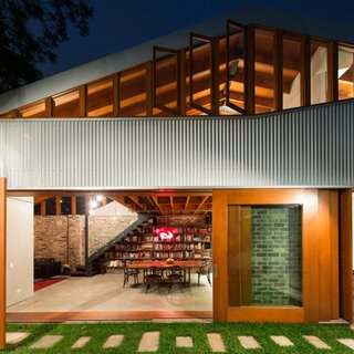 "Australian firm Carterwilliamson Architects converted a 19th-century cow shed into a residence that implements passive heating and cooling principles. ""Our clients share a vision for gregarious family life which is reflected in their home. The spaces are truly 'open plan. Each room is connected to the others and to the sunny, green courtyard that acts as a natural extension of the living spaces,"" says firm principal Shaun Carter."