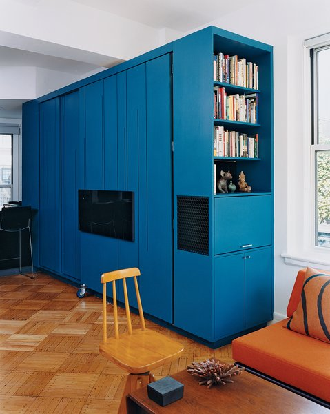 the blue-lacquered all-in-one cabinet in the fully closed position.