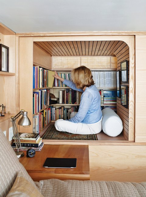 """Brooklyn architect Tim Seggerman designed and built what he calls a """"crafted jewel box"""". Utilizing the petite space in his New York apartment Seggerman creates an enveloping cabin of blond woods.  A Look at Reading Nooks by Diana Budds from 8 Modern Paneled Rooms"""