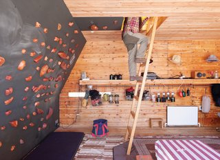 Setsumasa and Mami Kobayashi's weekend retreat, two and a half hours northwest of Tokyo, includes a rooftop tent that can be accessed from the interior via a wooden ladder or—for the more athletic—via a series of wall-mounted climbing holds, made by Vock and carved from persimmon-tinted hardwood. Photo by Dean Kaufman.