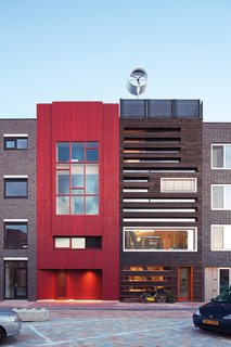 The striking black facade of Pieter Weijnen's home in IJburg, Amsterdam, is the result of the Japanese practice of charring wood. Weijnen, an architect at the Amsterdam firm Faro, first discovered charred wood through the work of Terunobu Fujimori and later traveled to the Japanese island of Naoshima to observe the traditional technique. Photo by Hans Peter Follmi.