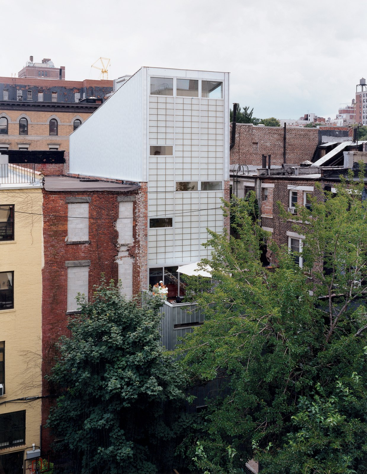 The house's 38-foot-high rear wall conceals the two-story stair.  McWhorter Vallee Design Inc.'s Favorites from Harlem Renaissance