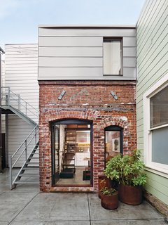 Architect and metalworker Christi Azevedo transformed a 93-square-foot brick boiler room—from 1916—into a loft-like guesthouse. She made the most of the vertical space to unleash the potential of the petite project.
