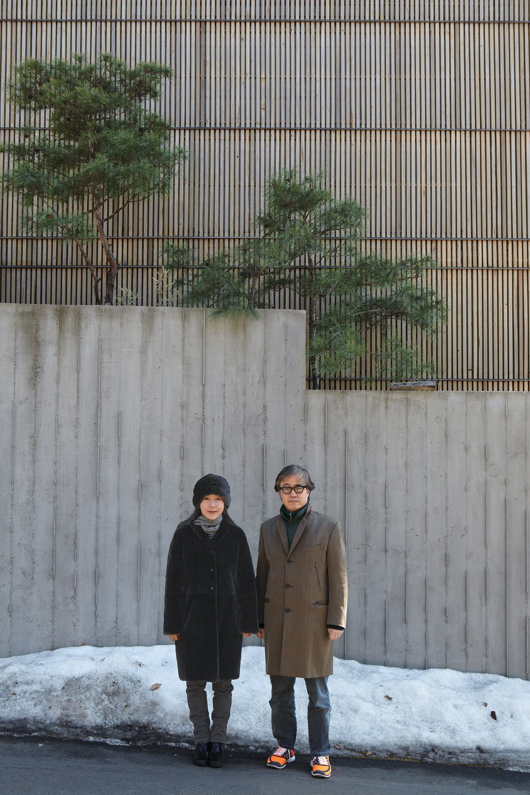 """Exterior and Concrete Siding Material Architect Byoung-soo Cho and his wife, Eunsil Kim, value the privacy, and style,   that a concrete wall and recycled Indonesian teak facade provide.  Search """"byoung cho"""" from Seoul, South Korea"""