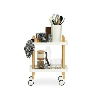 BLOCK TABLE  The light and airy design of Block Table, created by Danish designer Simon Legald, offers a fresh take on the familiar tray table. Outfitted with wheels and four handles extending from the legs, it is easy to move around as well as highly versatile. May be used as a bar cart, side table, tea table, coffee table or bedside table.