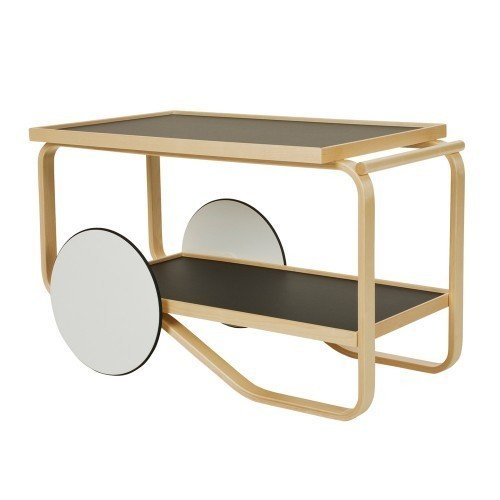 ARTEK 901 TEA TROLLEY  Designed by Alvar Aalto in 1936, the Tea Tray 901 is a surprisingly contemporary take on the bar tray. The sculpted, natural lacquered birch frame is paired with two shelves and white lacquered MDF wheels with black rubber rings. Mobile and captivating, the Tea Tray is perfect for taking your tea— or other beverage of choice— on the go.
