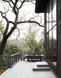 An L-shaped deck wraps around the house's ground level, creating a place for entertaining and taking in the scenery.