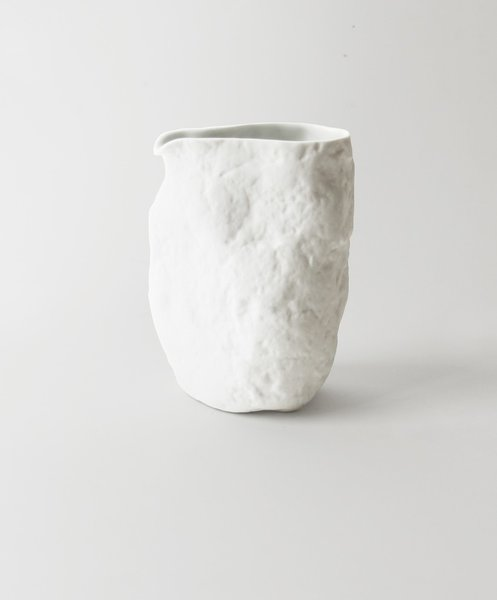 Sake Pitcher by Japanese Ceramics, $44 stillhousenyc.com  From Maarten Baas to Jens Faber, we love a rough-hewn take on a traditional silhouette. This affordable, snowy white pitcher is made in Japan (in an area known for its mastery of porcelain) from high-fired ceramic with a glazed interior.
