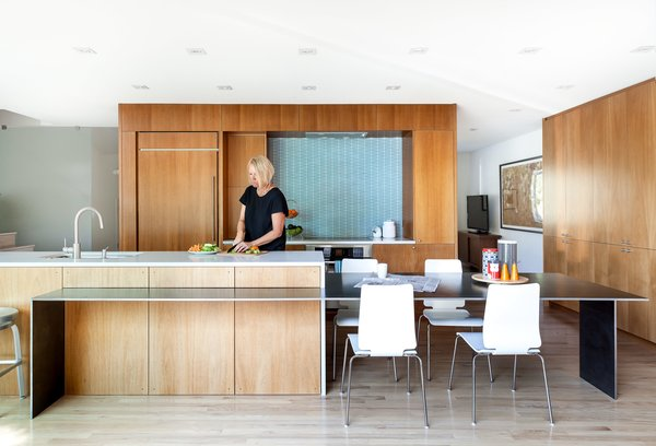 Hawkins removed walls and swapped outdated storage for floor-to-ceiling African mahogany cabinetry.