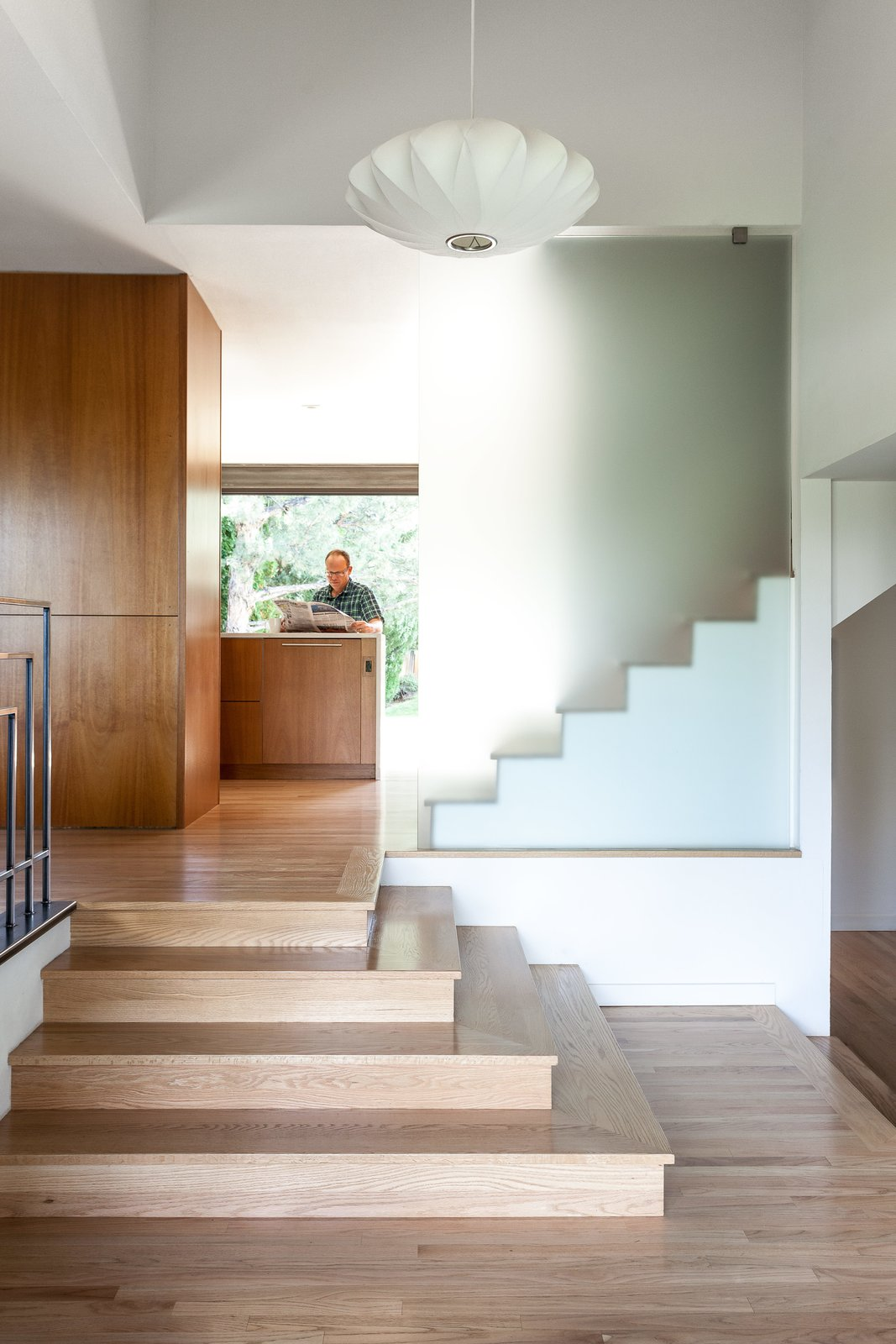 Staircase and Wood Tread A George Nelson pendant hangs in the reconfigured entrance hall, whose stairs echo the concrete steps off the back deck.  190+ Best Modern Staircase Ideas from A Completely Dysfunctional Nevada Kitchen Becomes Everyone's Favorite Spot for Parties