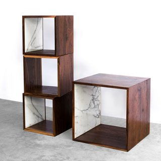The Walnut and Marble Storage Cube from 2131 takes the simplicity of a box and elevates it with rich walnut wood and luxe marble. The cube includes one interior surface that has been inlaid with Italian Calacatta Gold marble, which elegantly frames the storage cube's contents. Available in small and large sizes, the Walnut and Marble Cubes can be stacked to create a distinctive storage display, or they can be used individually as a striking accent.