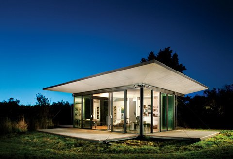 Exterior, Cabin, Flat, Metal, and Glass This small writer's retreat on San Juan Islands, Washington completely exposes the interior to the site's impressive island views. Photo by: Tim Bies  Best Exterior Glass Cabin Flat Metal Photos from Serene Havens on Puget Sound and the San Juan Islands