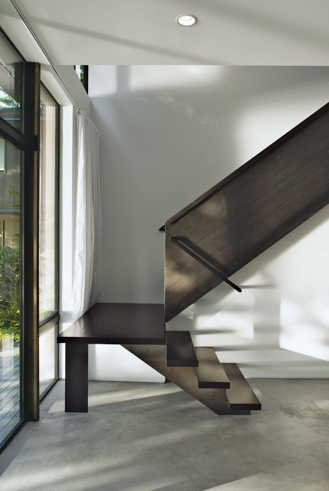 """Staircase Steel allowed Kunding to be playful with the staircase's form.  Search """"staircase"""" from Staircases We Love"""