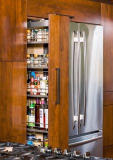 The refrigerator is by Jenn-Air, and the oven cooktop and dishwasher are by Thermador.
