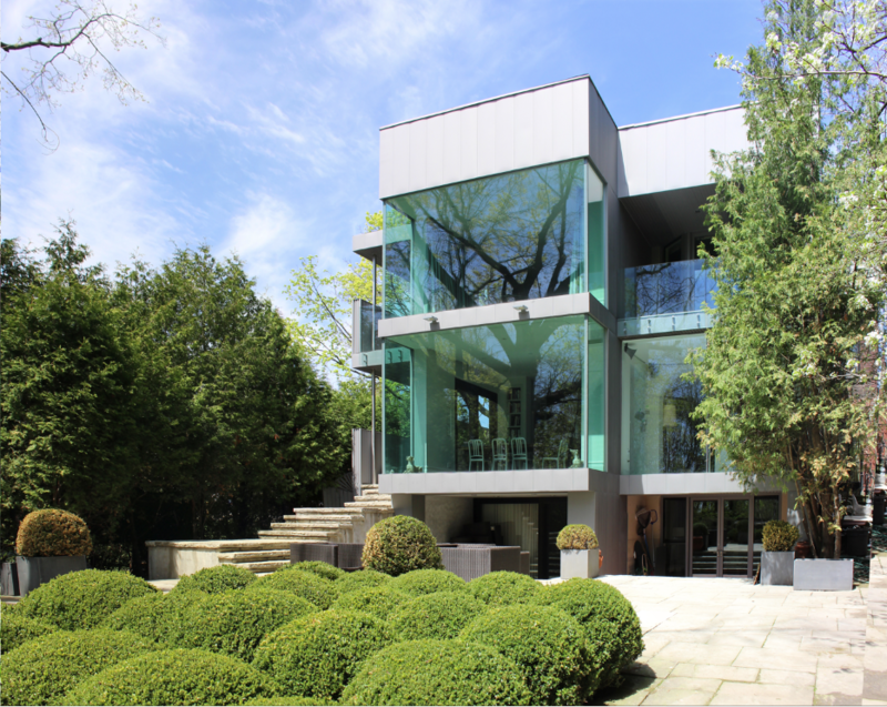 """In Toronto, Canada, architect Anthony Provenzano renovated a home for a client that was inspired by the acquisition of a piece by artist Rikrit Tiravanija. """"It was a project that started when the clients acquired the other side of the semi-detached home they lived in,"""" says Provenzano. """"A decade passed after an initial 'connection' renovation and when the clients purchased an art piece by Rirkrit Tiravanija, we were contacted, as it precipitated a major architectural renovation at the rear of the house and a landscape intervention centered about the aforementioned art piece."""" The resulting renovation, shown above, was completed with an eye towards clarifying the structure's connection to the garden."""