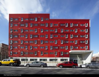 "Navy Green Supportive Housing (Architecture in Formation)  The bright red structure, called a ""billboard building"" by the architects, is meant to be a symbol and anchor for the mixed-income Navy Yard development. A cutting-edge home for the chronically homeless, the building's interior and garden—complete with a ""rampitheater"" for those with mobility issues—has won awards for its user-centric design."