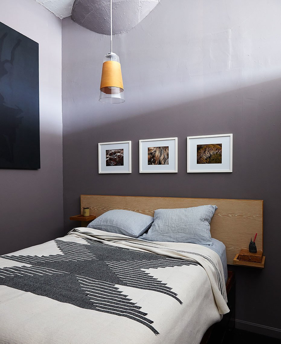 Woodworking is another of Owen's hobbies and his bedroom features a bed and closet he designed and built himself. A blanket from Joinery complements the wood grain of the custom headboard. The pendant light was a flea market find.  Nicholas bedroom ideas