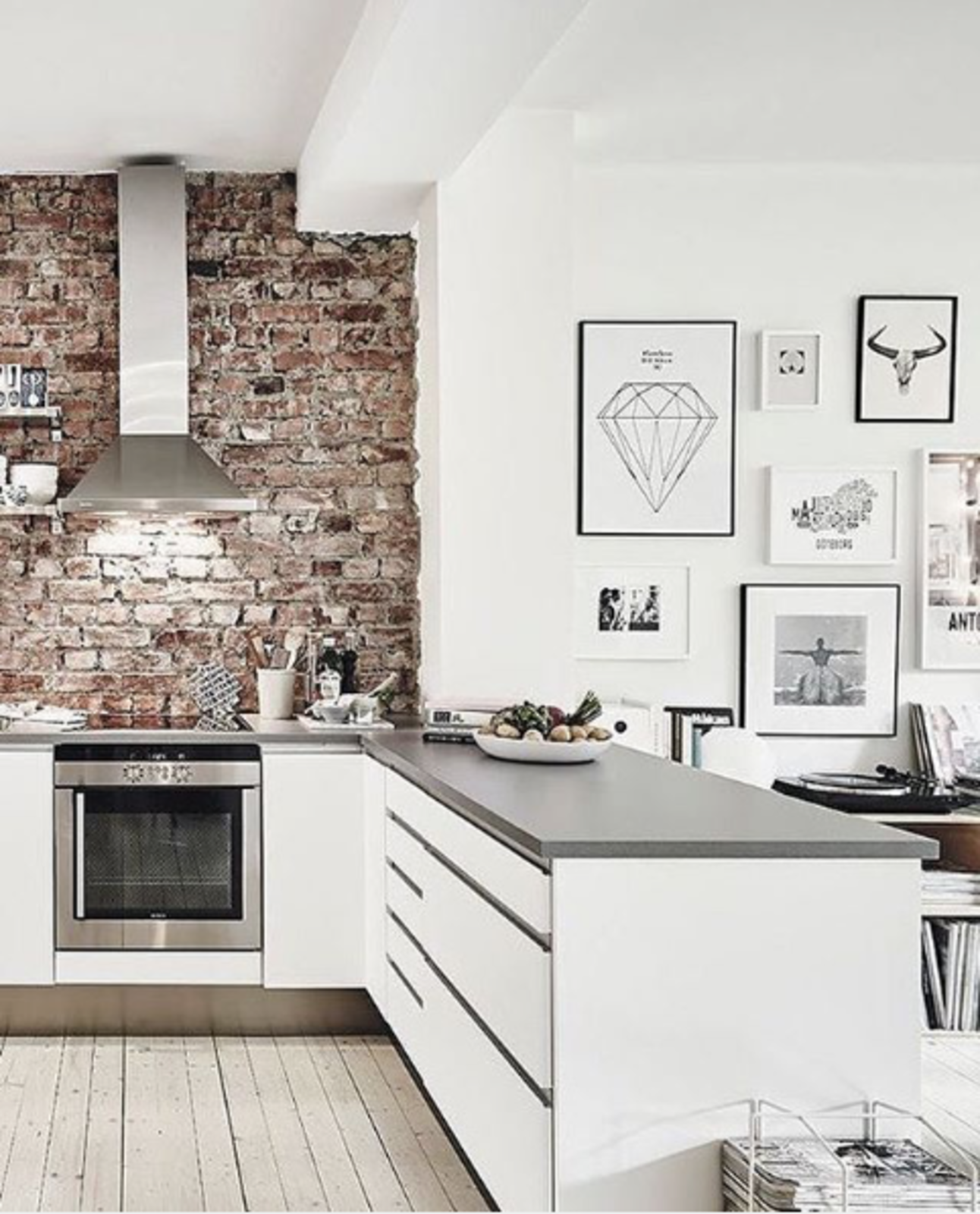 With an exposed brick wall and mesmerizing graphic art, this kitchen, posted by @abigailclaireinspo, feels particularly on-trend.  exposed brick from Spotted on Instagram: Five Totally Different Styles for Your Kitchen