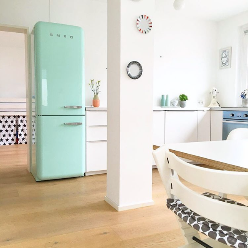 @solebich shared this photo of a bright kitchen-dining area with a turquoise Smeg refrigerator.