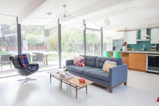 Originally designed by the architectural dream team of A. Quincy Jones and Frederick Emmons, this Eichler sports a new kitchen. One highlight is the island, which the design team crafted in the owners' own backyard. It's outfitted with bespoke walnut cabinetry by Semihandmade for IKEA. Photo by John Shum.