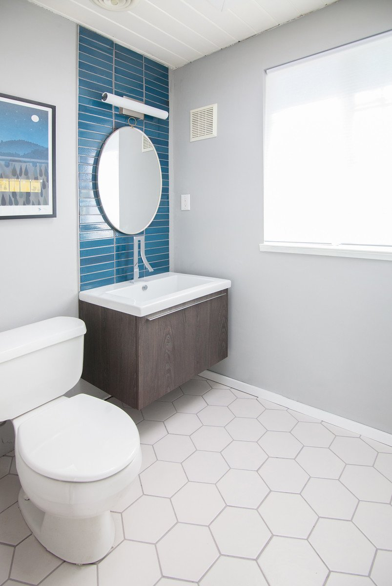 Bath, Wall Mount, and Two Piece The renovated bathroom features tiles from Heath Ceramics.  Best Bath Two Piece Wall Mount Photos from DIY All-Stars! A Family Rolls Up Their Sleeves and Restores an Eichler