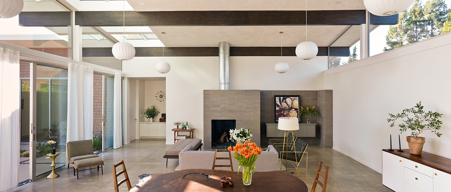 The interior palette is simple, with concrete floors and plaster ceilings. The fireplace, made of stacked Roman brick, is another design move commonly seen in midcentury houses.  If Eichler Designed a House Today, This Is What It Might Look Like by Allie Weiss