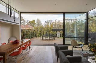 From the start of the project, a tangible connection to the rear garden was at the top of the clients' wish list. This fluid transition from the living room is enhanced by ceiling height steel framed double-glazed sliders. Clerestory windows bring additional light in, and enhance the feeling of openness.
