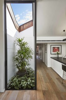 An internal courtyard punctuates the main floor of this renovated home near Melbourne, Australia, and adds a practical source of light and air. The local climate patterns were taken into account during the home's design and layout. Because temperatures can vary quite dramatically, solar control was very important. The large glazed sliders to the east, where the home gets morning sun, strategically contrast with the less extensive glazing to the north.