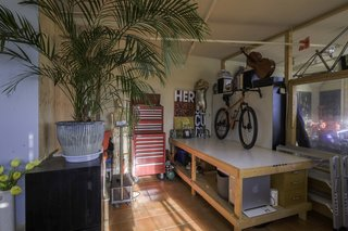 This table is where Mark paints and assembles his bicycles; he built the table and the bike standing upon it. The tall roller cabinet is from Homak.