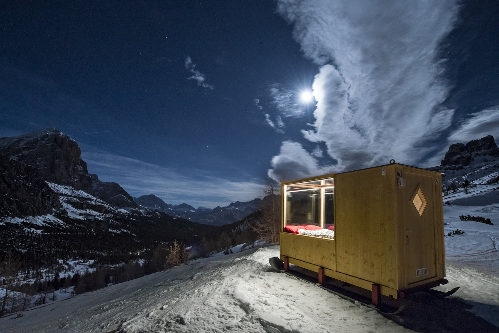 Located about 12.5 miles outside Cortina d'Ampezzo, guests arrive via snowshoes or snowmobile.  Off the grid from One Stunning Panorama, 6,742 Feet High Up in the Alps