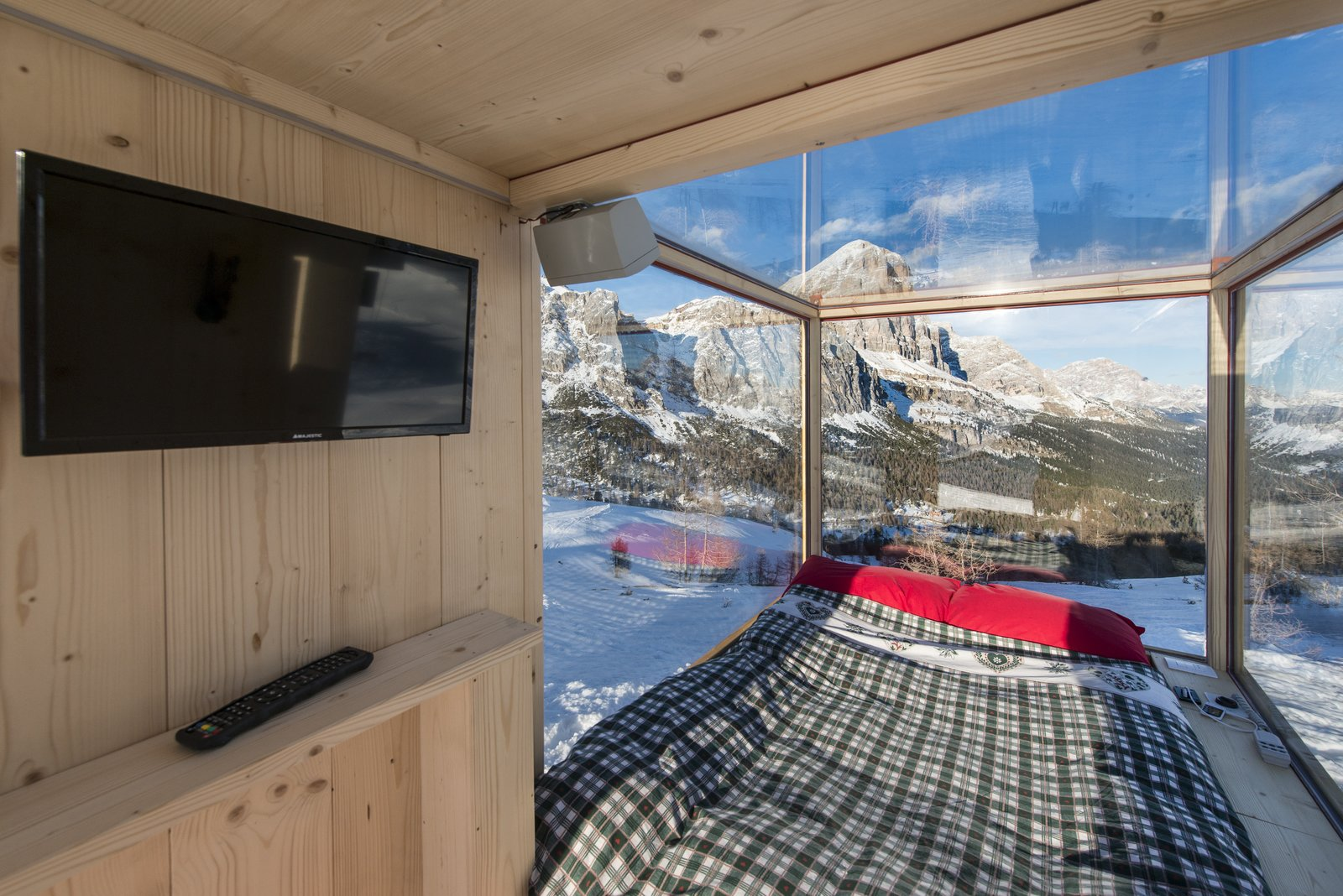The interior is climate-controlled and ideal for star watching.  Modern Winter Retreats from One Stunning Panorama, 6,742 Feet High Up in the Alps