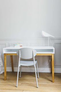 A simple work space features an Angelpoise lamp and a desk from La Redoute Interieurs.