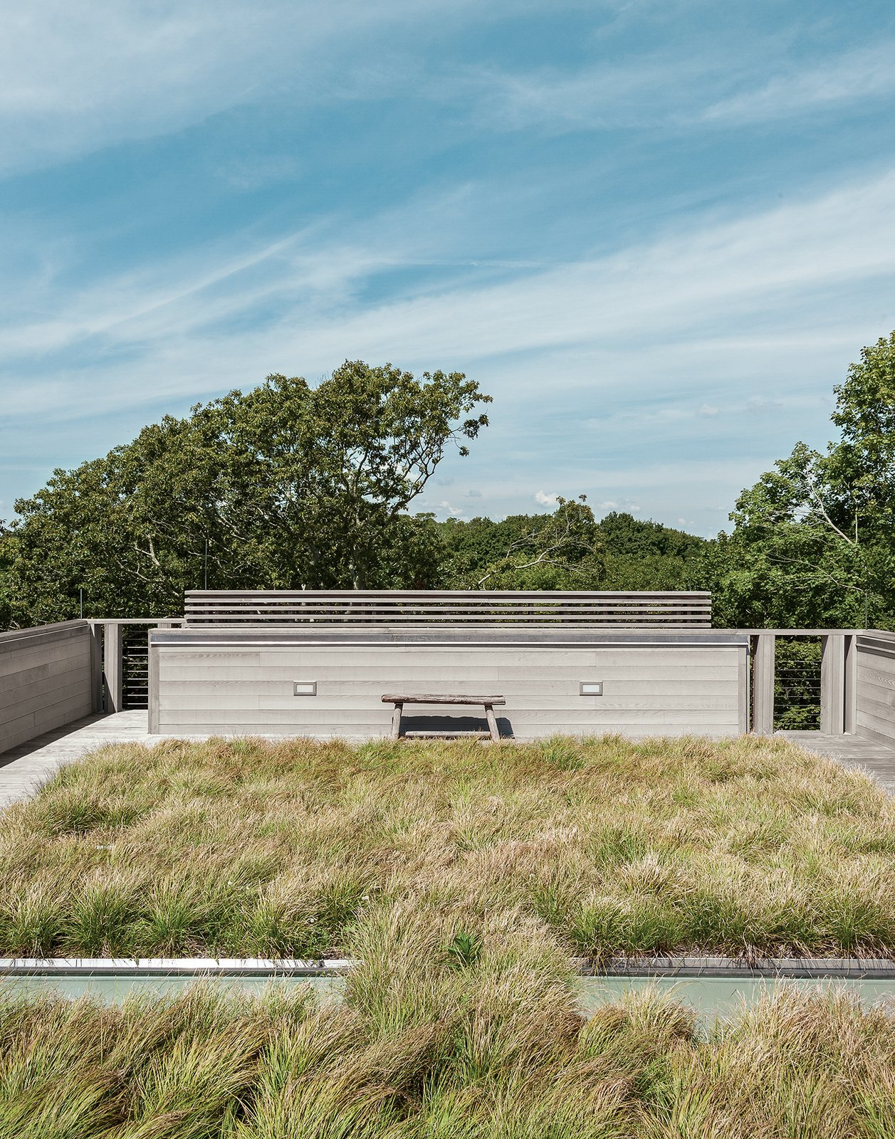 """Outdoor and Rooftop Landscape architects Reed Hilderbrand helped fill out the completed prefab by planting sedge grass on one of the house's two green roofs to reflect the texture of the surrounding meadow.  Search """"bright green prefab sweden looks just monopoly house"""" from An Unconventional Prefab on Fishers Island"""