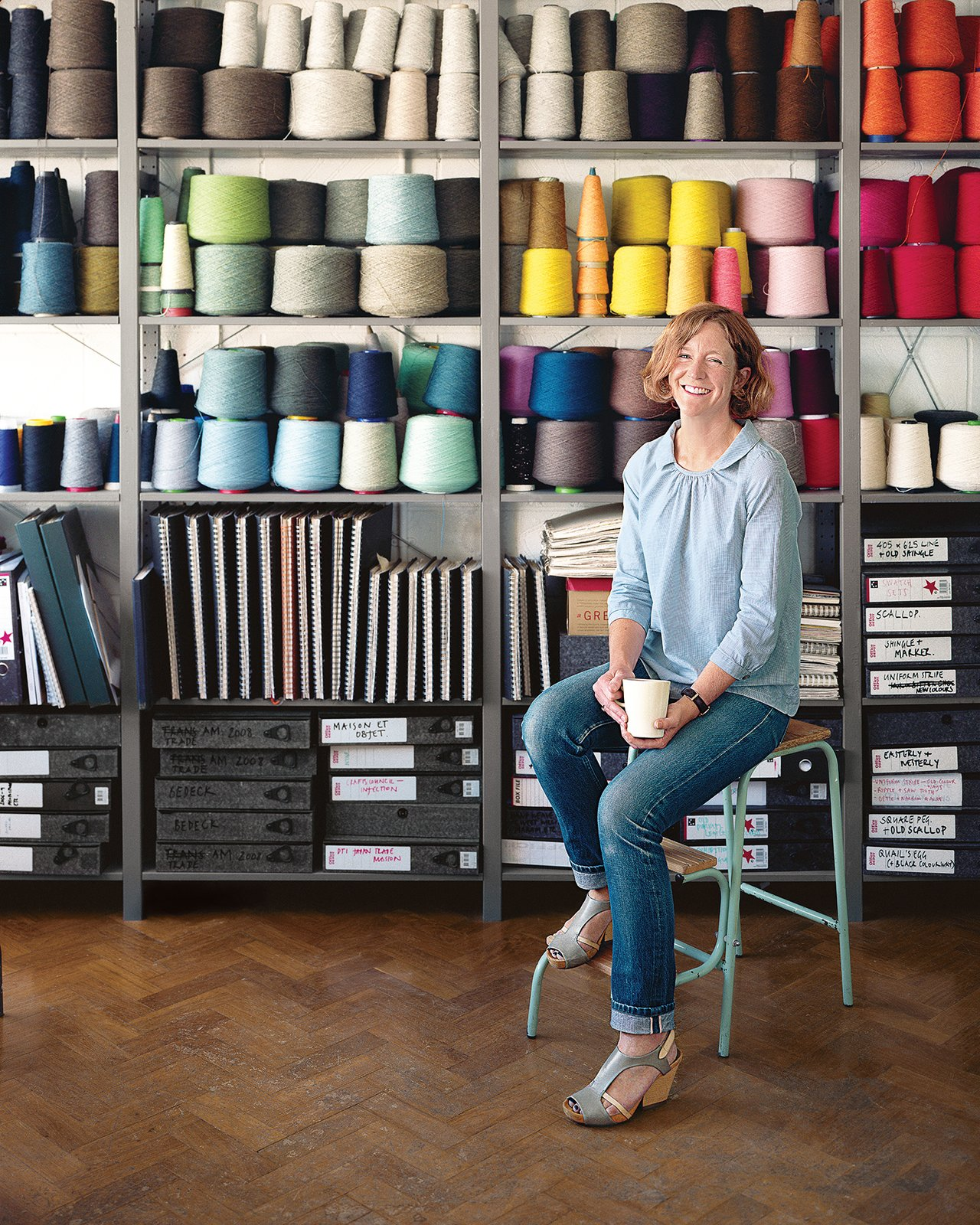 London-based designer Eleanor Pritchard sources Shetland lambswool from mills across the United Kingdom for her blankets, pillows, and upholstery. She designs the fabric patterns in her Deptford studio, near Greenwich, in a converted warehouse called Cockpit Studios.  Photo 2 of 7 in A Look Inside Eleanor Pritchard's Textile Studio