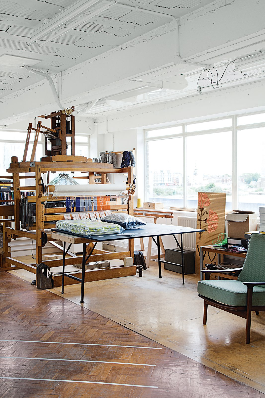 "Pritchard uses her 30-year-old George Wood dobby loom to make in-house samples. The loom is of the ""peg-and-lag"" variety, in which a pattern is made by a machine that works from a binary code. ""It's an old workhorse,"" says Pritchard, ""and has done a lot of mileage over the years!""  Photo 1 of 7 in A Look Inside Eleanor Pritchard's Textile Studio"
